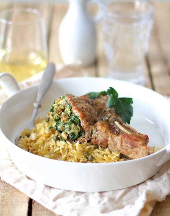 Sicilian Stuffed Pork Chops with White Wine and Caper Sauce Recipe   HeyFood — heyfoodapp.com