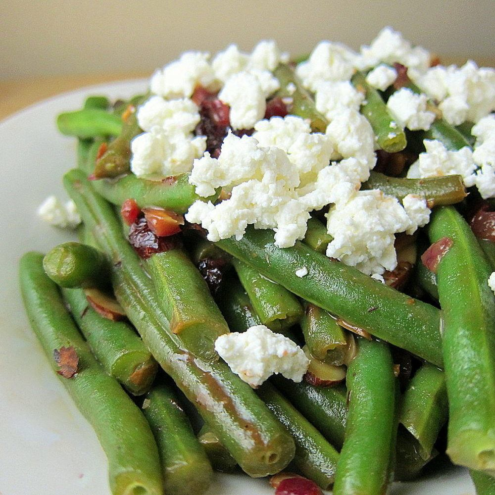 Green Beans with Cranberries, Almonds, and Goat Cheese in a Fig BalsamicGlaze Recipe | HeyFood — heyfoodapp.com