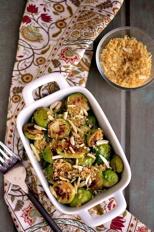Pan Seared Brussels Sprouts with Toasted Almonds Recipe   HeyFood — heyfoodapp.com