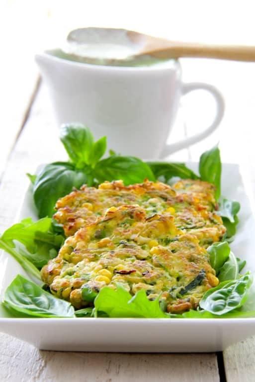 Zucchini Corn Cakes with Basil Buttermilk Sauce Recipe | HeyFood — heyfoodapp.com