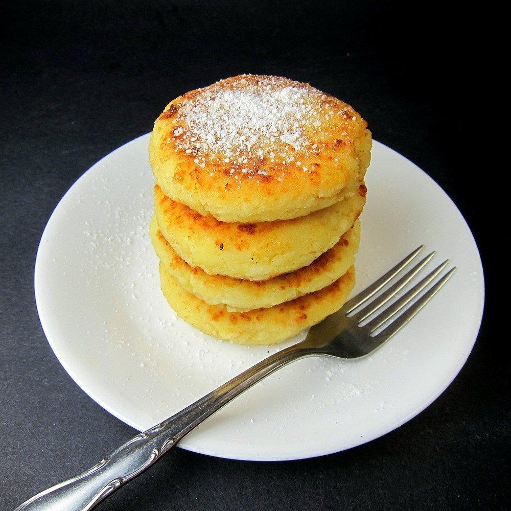 Syrniki Recipe (Russian Cheese Pancakes) Recipe   HeyFood — heyfoodapp.com