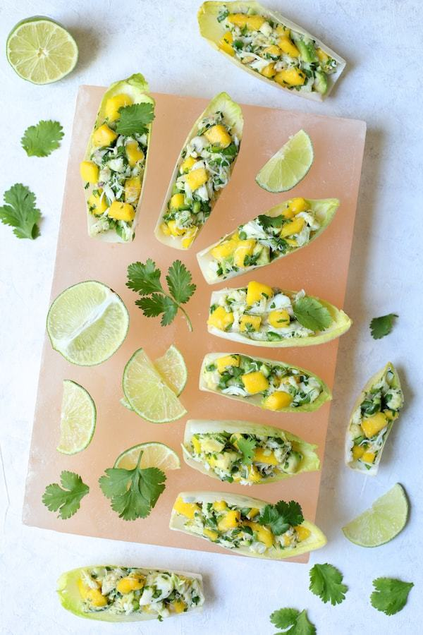 Crab Mango and Avocado Salad with Chile Lime Dressing in Endive Recipe | HeyFood — heyfoodapp.com
