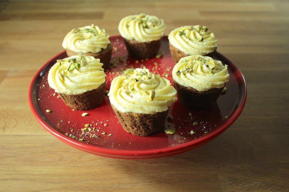 Carrot and Pistachio Muffins with White Chocolate Frosting Recipe | HeyFood — heyfoodapp.com