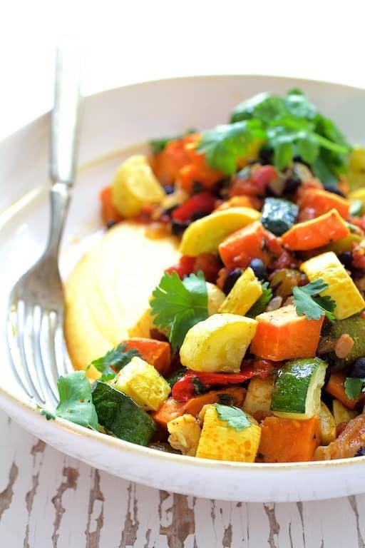 Spicy Roasted Vegetable Ragout with Black Beans and Polenta Recipe | HeyFood — heyfoodapp.com
