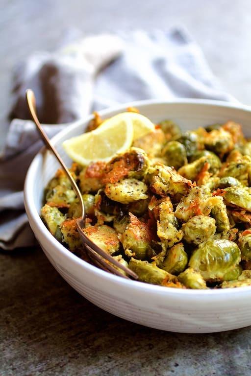 Lemon Parmesan Crusted Brussels Sprouts Recipe | HeyFood — heyfoodapp.com