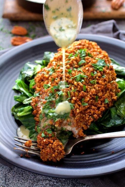 Baked Catfish Pecan Meuniere with Spicy Sauteed Greens Recipe | HeyFood — heyfoodapp.com