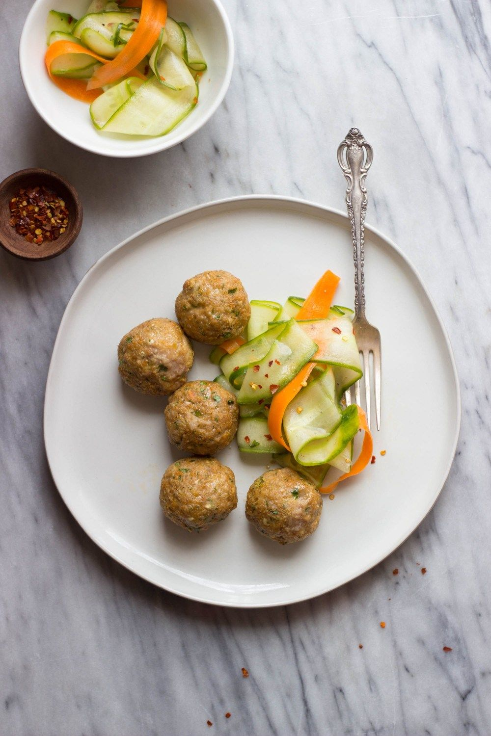 Asian-Style Pork Meatballs + Sesame Cucumber Salad Recipe | HeyFood — heyfoodapp.com