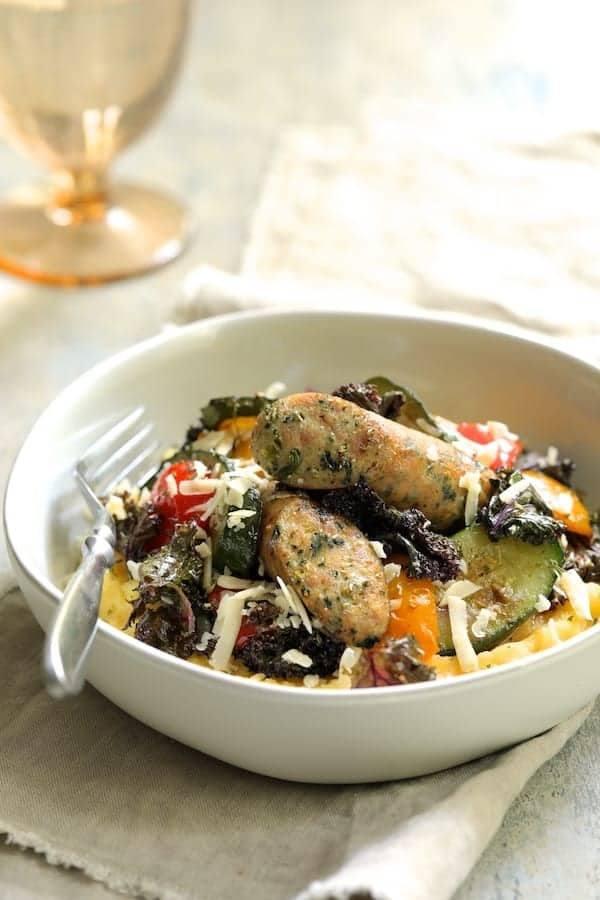 Mediterranean Sheet Pan Chicken Sausage and Vegetables with Garlic Parmesan Polenta Recipe | HeyFood — heyfoodapp.com
