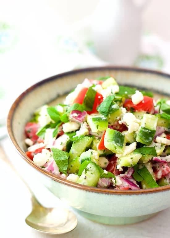 Cucumber, Tomato and Red Onion Salad with Yogurt - Mint Dressing and Feta Cheese Recipe | HeyFood — heyfoodapp.com