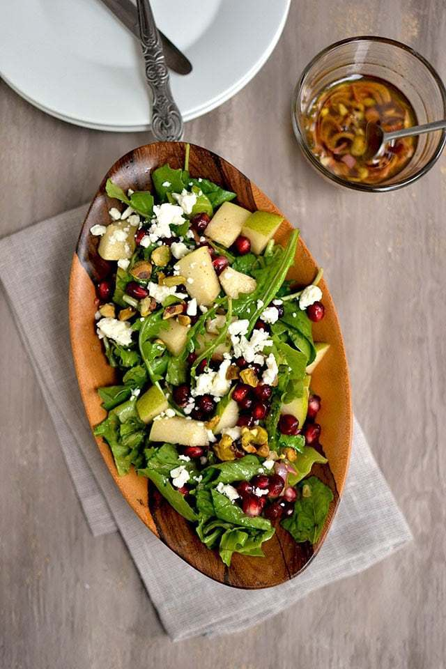 Arugula & Pear Salad with Pomegranate Vinaigrette Recipe | HeyFood — heyfoodapp.com