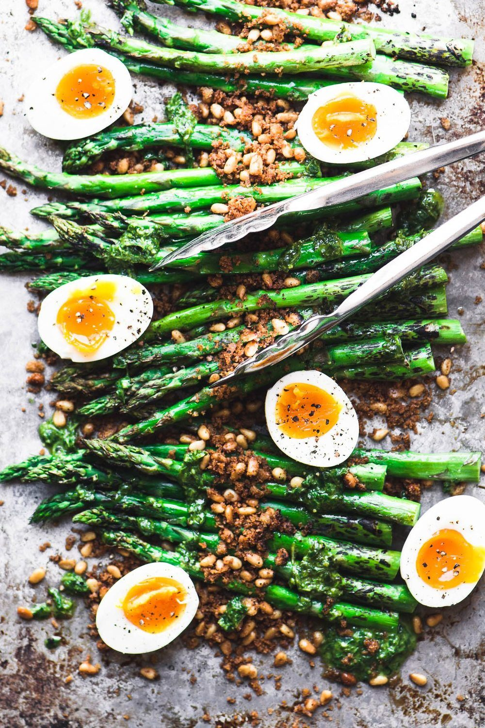 Roasted Asparagus with Crispy Breadcrumbs, Pine Nuts, and Runny Eggs Recipe | HeyFood — heyfoodapp.com