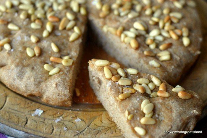 Whole Wheat Skillet Focaccia with Pine Nuts Recipe | HeyFood — heyfoodapp.com
