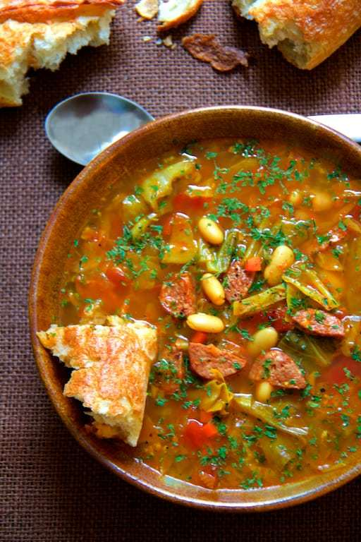 Farmhouse Cabbage Soup with Cannellini Beans and Kielbasa Recipe | HeyFood — heyfoodapp.com