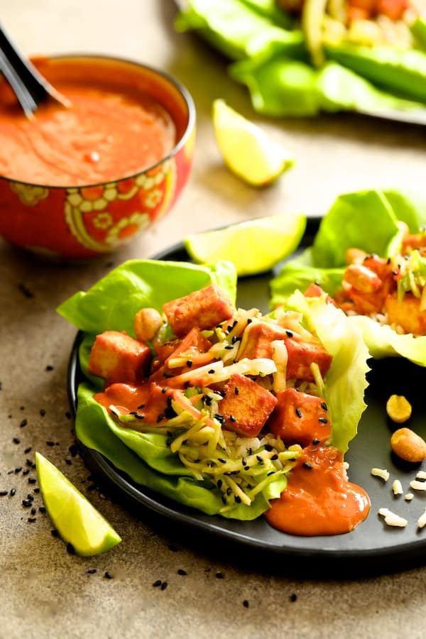 Vegan Korean Tofu Lettuce Wraps with Tahini Gochujang Sauce and Spicy Slaw Recipe | HeyFood — heyfoodapp.com