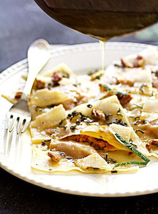 Pumpkin Ravioli with Sage Browned Butter Parmesan and Pecans Recipe | HeyFood — heyfoodapp.com
