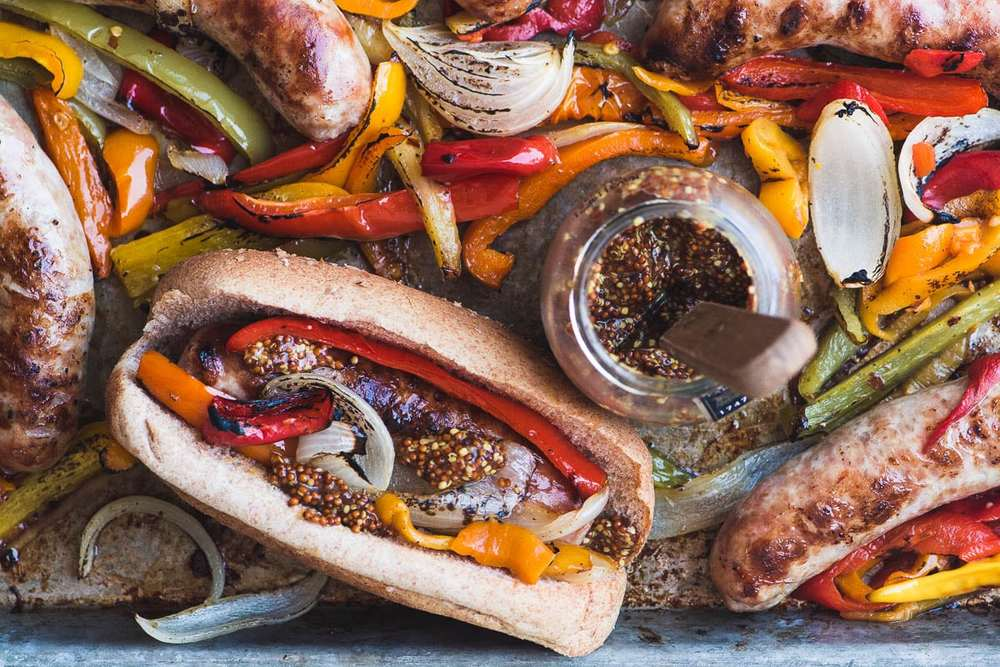 Sheet Pan Peppers and Brats Recipe | HeyFood — heyfoodapp.com