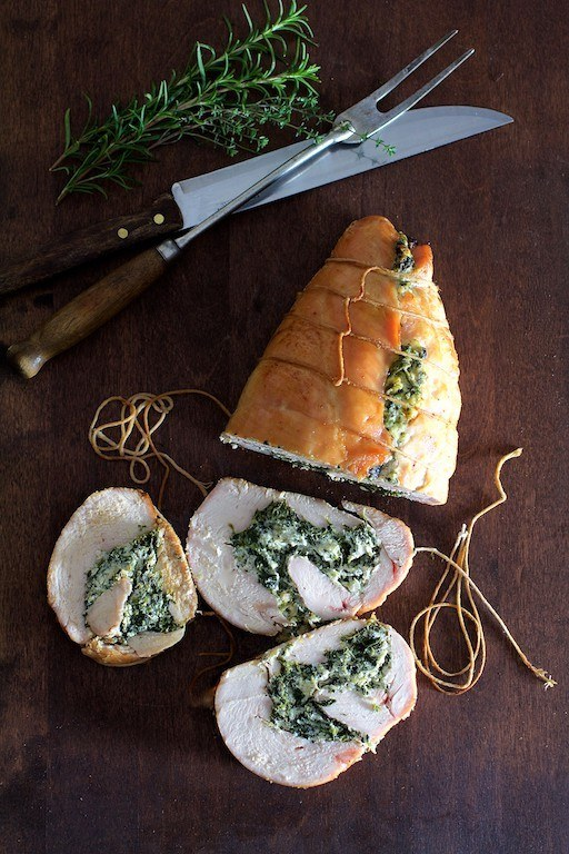 Spinach and Ricotta Stuffed Turkey Breast with Garlic Herb Sauce Recipe | HeyFood — heyfoodapp.com