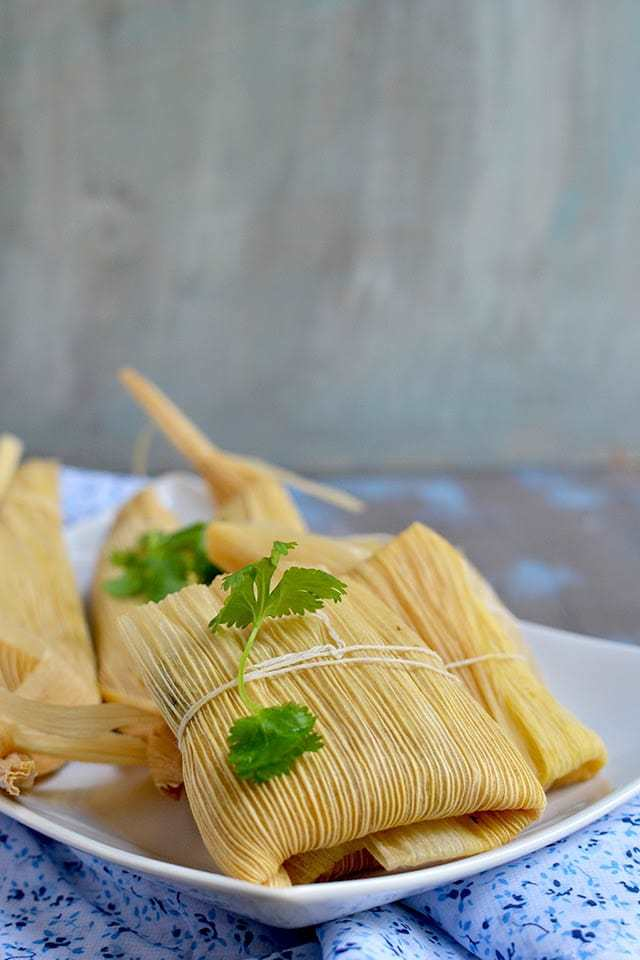 Vegetarian Tamales with Spinach, Corn and Cheese Filling Recipe | HeyFood — heyfoodapp.com