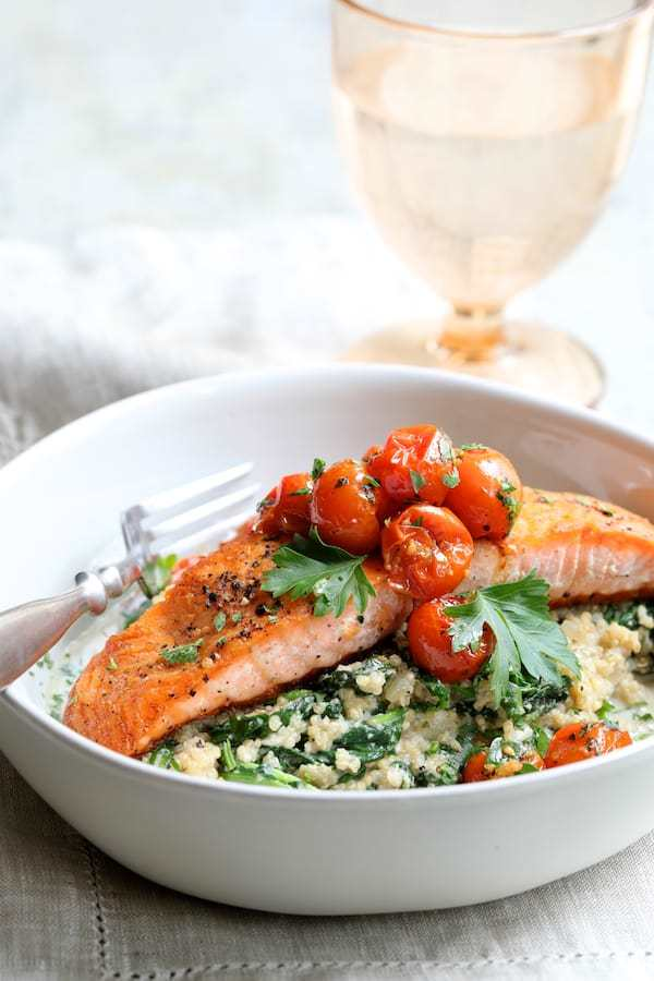 Seared Salmon with Baby Kale Quinotto and Warm Roasted Cherry Tomato Salad Recipe | HeyFood — heyfoodapp.com