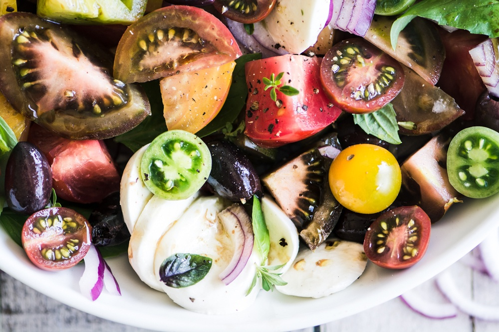 Heirloom Caprese Salad with Kalamata Olive Vinaigrette Recipe | HeyFood — heyfoodapp.com