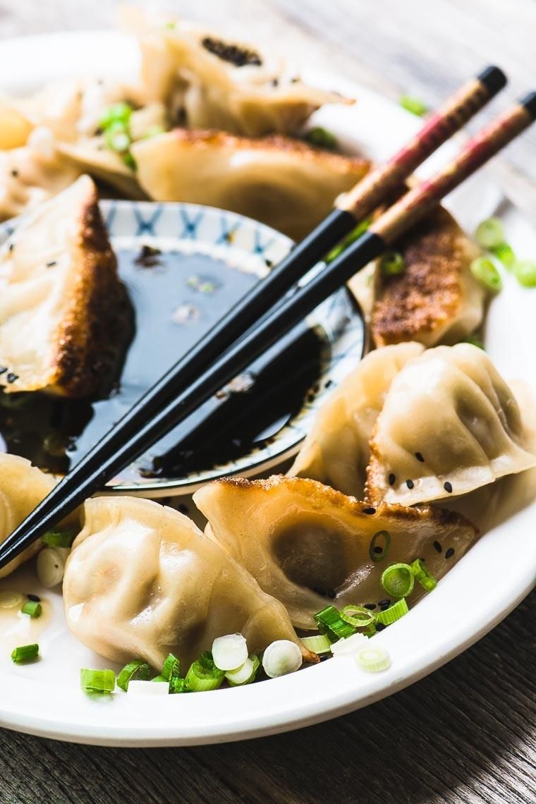 Japanese Pork Dumplings with Ginger and Green Onion Recipe | HeyFood — heyfoodapp.com