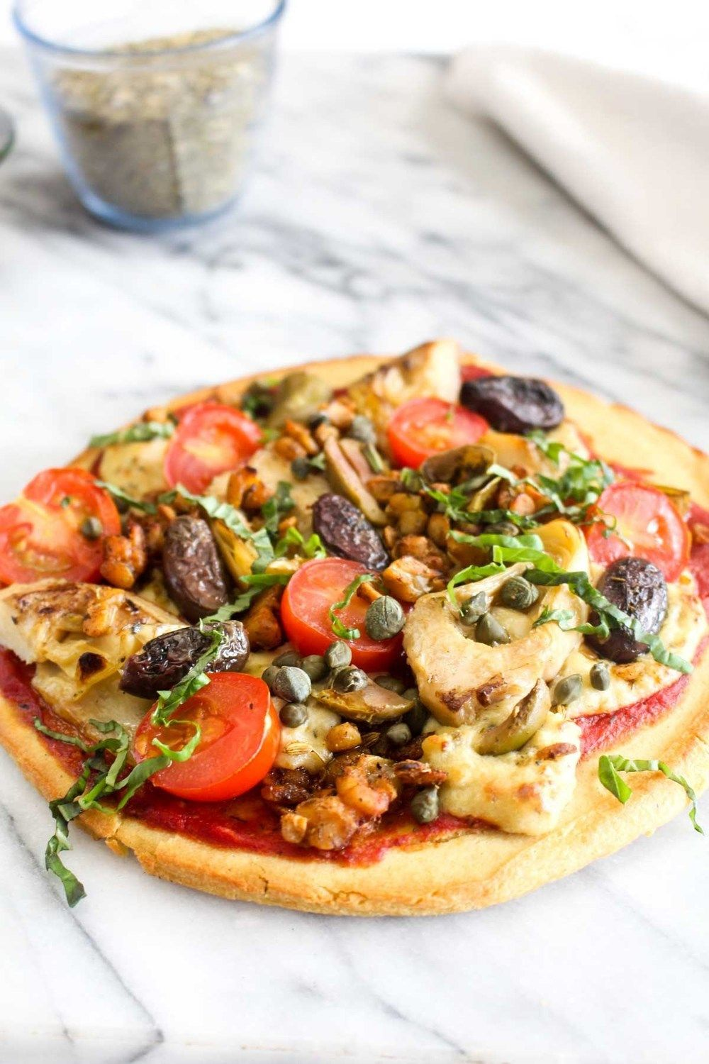 Vegan Antipasti Pizza with Gluten Free Socca Crust Recipe | HeyFood — heyfoodapp.com