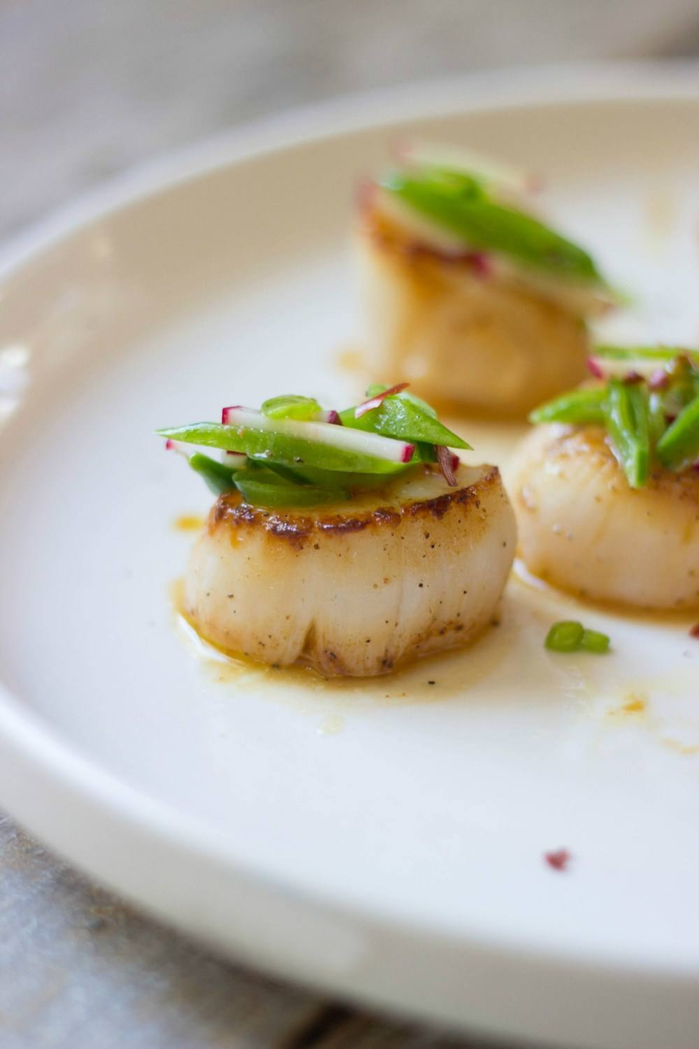 Orange-Ginger Seared Scallops + Sugar Snap Pea Slaw Recipe | HeyFood — heyfoodapp.com