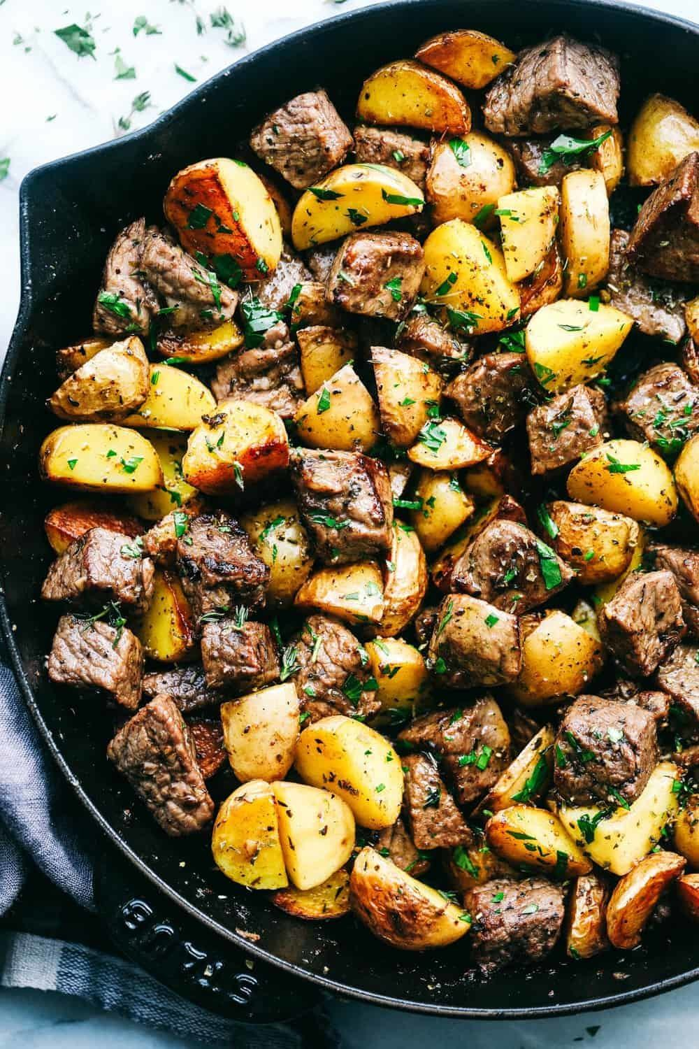 Garlic Butter Herb Steak Bites with Potatoes Recipe | HeyFood — heyfoodapp.com