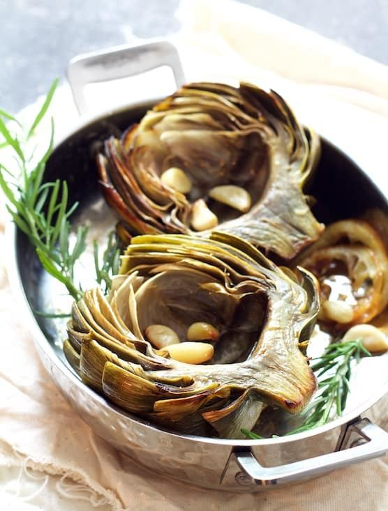 Oven Roasted Artichokes with Roasted Garlic Butter Recipe | HeyFood — heyfoodapp.com