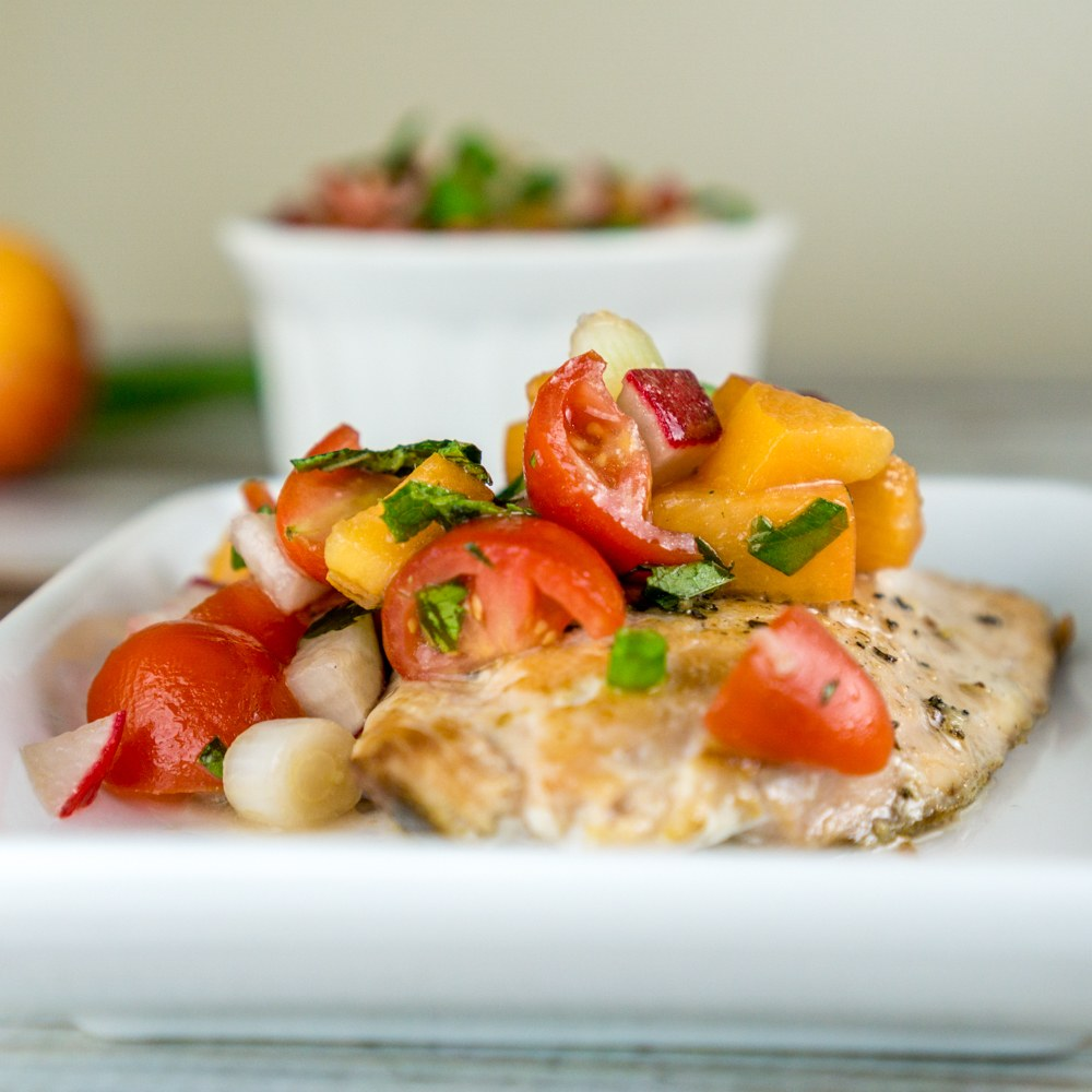 Pan-Seared Salmon with Tomato Apricot Relish Recipe | HeyFood — heyfoodapp.com