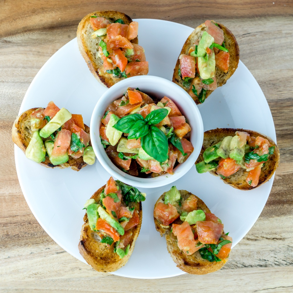 Tomato Avocado Bruschetta Recipe | HeyFood — heyfoodapp.com