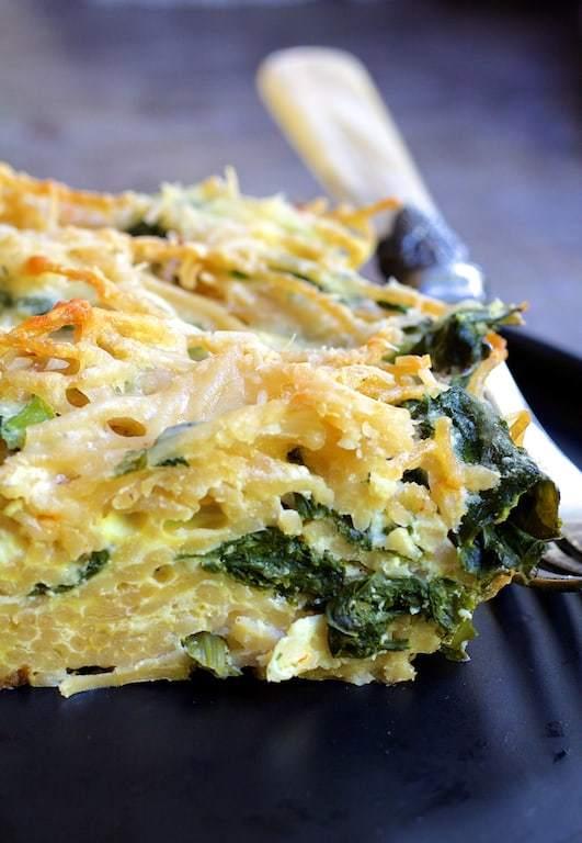 Baked Spaghetti Frittata with Broccoli Rabe, Bacon and Three Cheeses Recipe | HeyFood — heyfoodapp.com