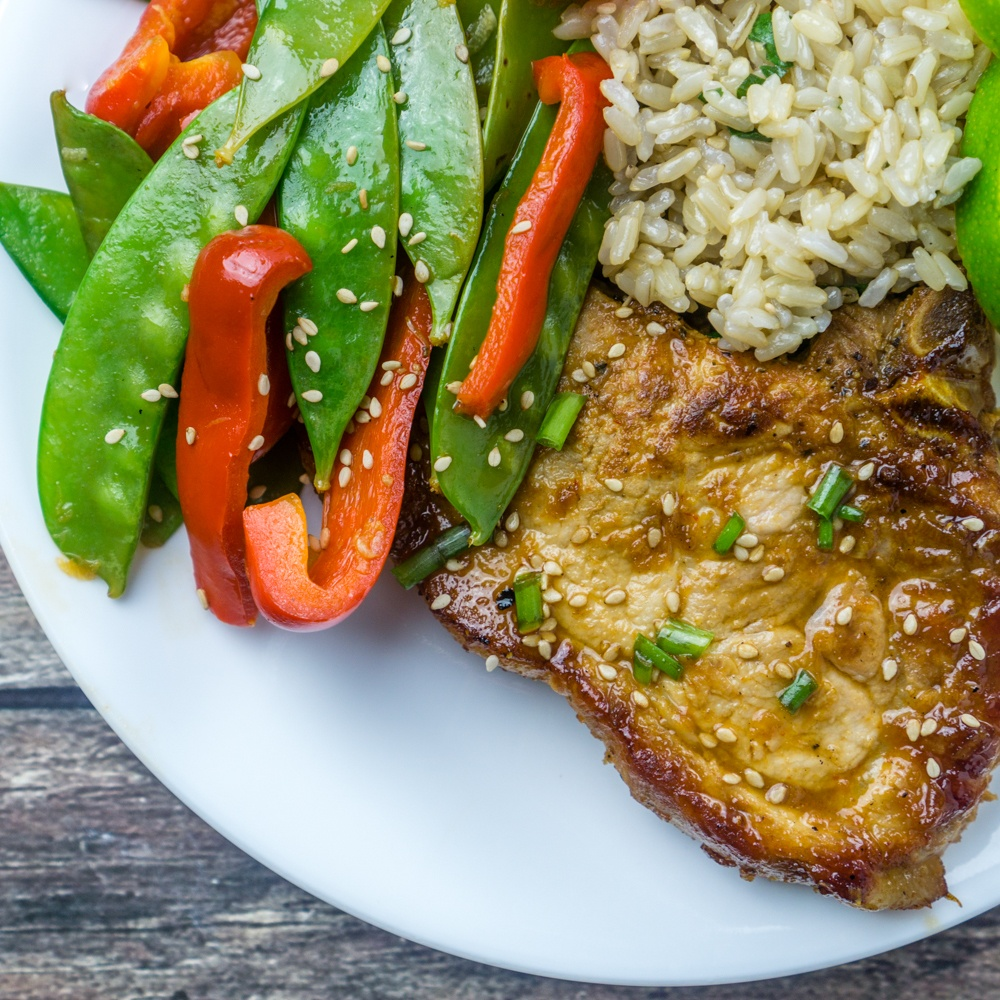 Honey Sriracha Glazed Pork Chops with Stir Fried Veggies Recipe | HeyFood — heyfoodapp.com