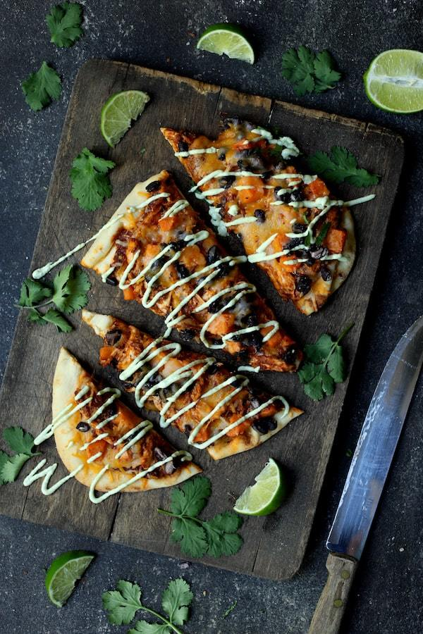 Chipotle Chicken Sweet Potato and Black Bean Flatbread Pizzas with Avocado Sour Cream Recipe | HeyFood — heyfoodapp.com