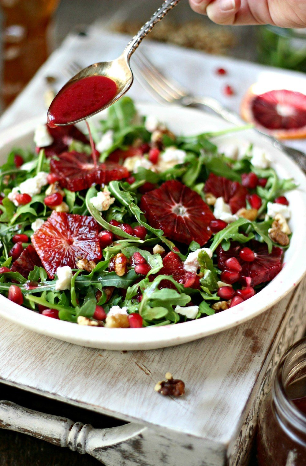 Arugula, Blood Orange and Honey Goat Cheese Salad with Pomegranate Vinaigrette Recipe | HeyFood — heyfoodapp.com