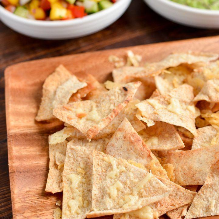 Crispy Cheddar Pita Chips With Guacamole And Mango Salsa Recipe | HeyFood — heyfoodapp.com