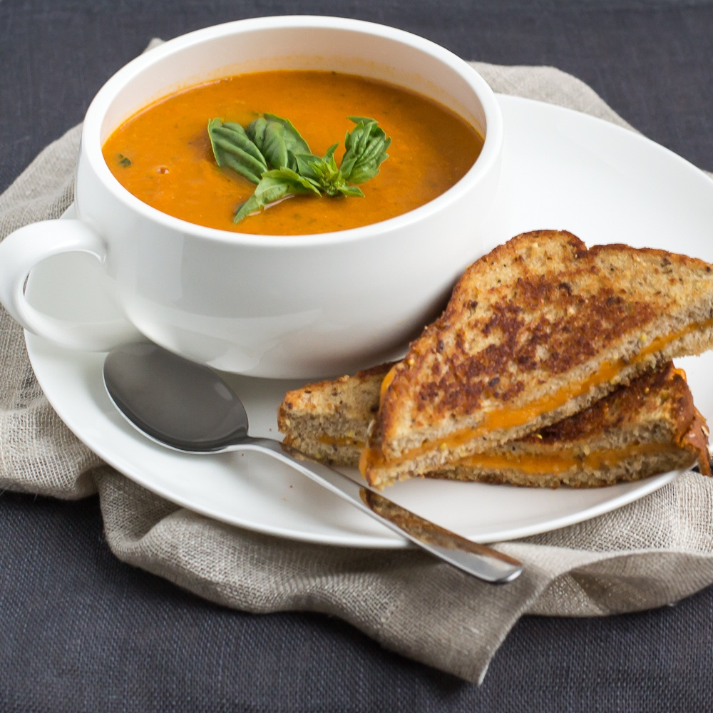 Tomato-Basil Soup With Cheddar Grilled Cheese Recipe | HeyFood — heyfoodapp.com