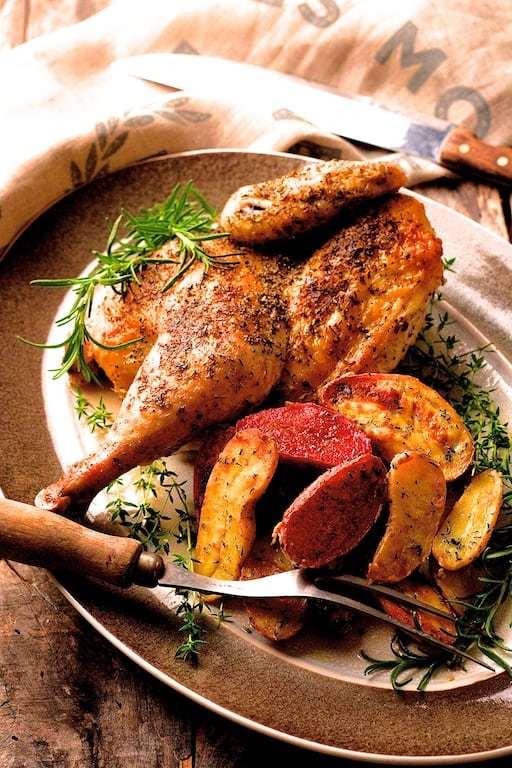 Herb and Garlic Roasted Chicken with Dijon Rosemary Roasted Fingerling Potatoes Recipe | HeyFood — heyfoodapp.com
