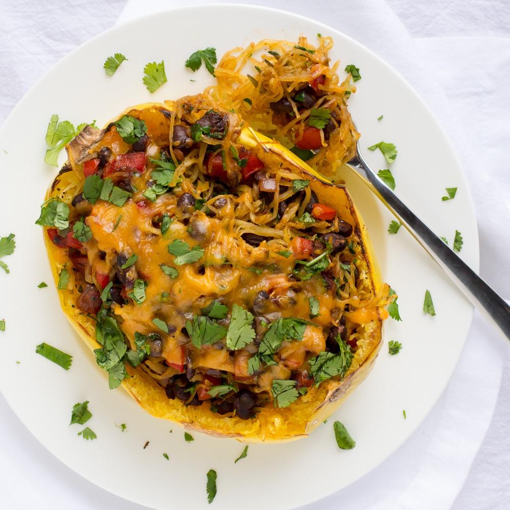 Southwestern Stuffed Spaghetti Squash With Black Beans Recipe | HeyFood — heyfoodapp.com