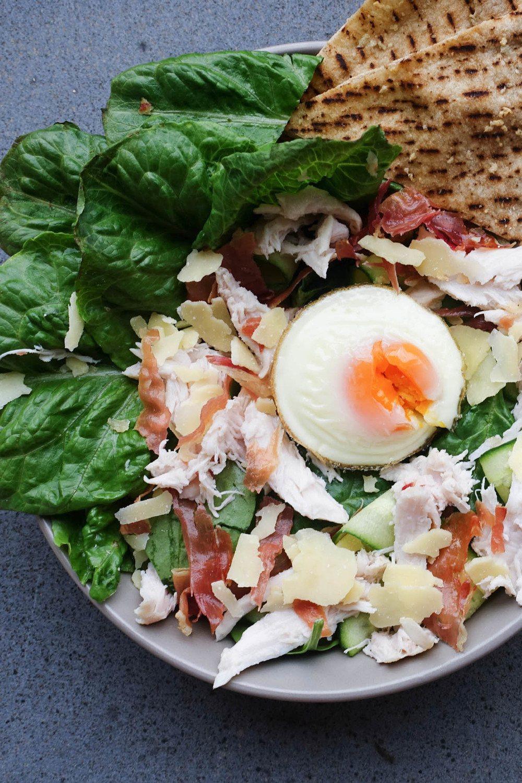 Easy Chicken Caesar Salad with Crispy Garlic Pita Chips Recipe   HeyFood — heyfoodapp.com