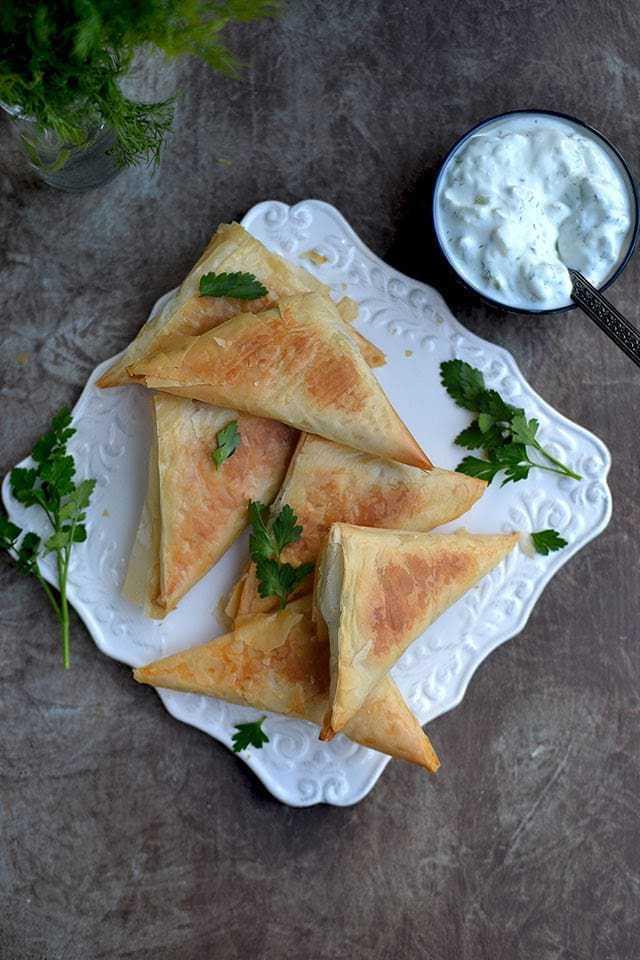 Spanakopita Triangles Recipe | HeyFood — heyfoodapp.com