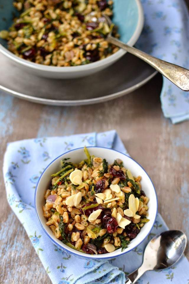 Warm Farro Pilaf with Dried Cranberries & Kale Recipe | HeyFood — heyfoodapp.com