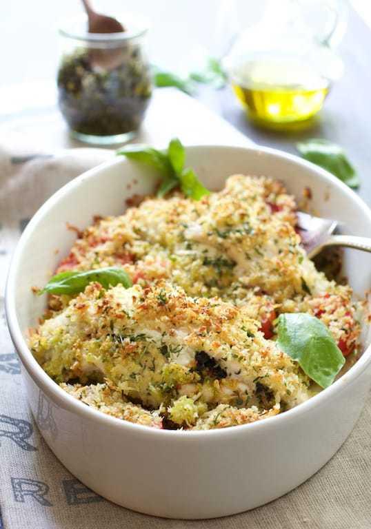 Gratin-Style Pesto and Goat Cheese-Stuffed Chicken with Roma Tomatoes Recipe   HeyFood — heyfoodapp.com