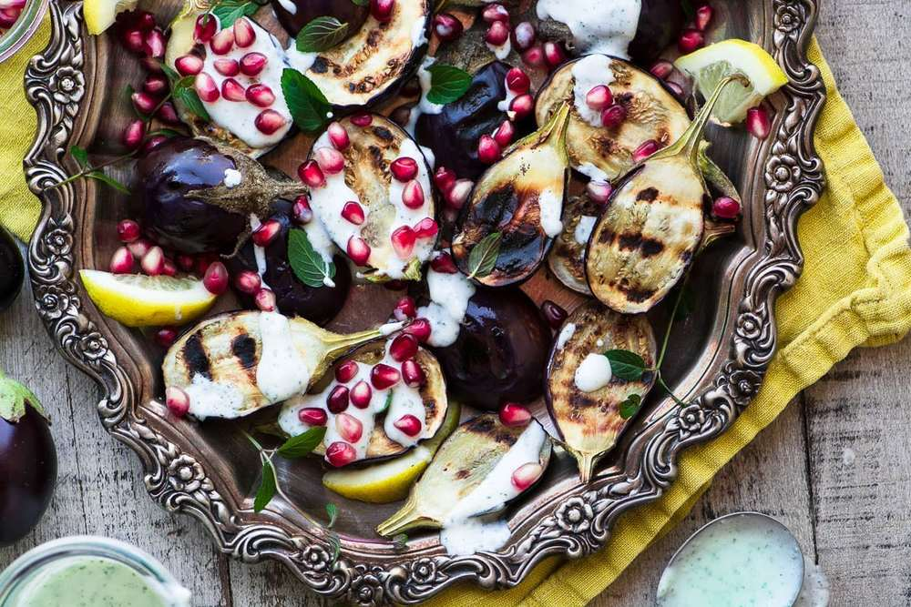 Grilled Baby Eggplant with Minted Yogurt and Pomegranate Recipe | HeyFood — heyfoodapp.com