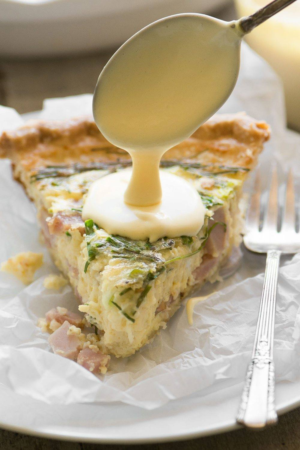 Eggs Benedict Quiche with Hollandaise Sauce Recipe | HeyFood — heyfoodapp.com