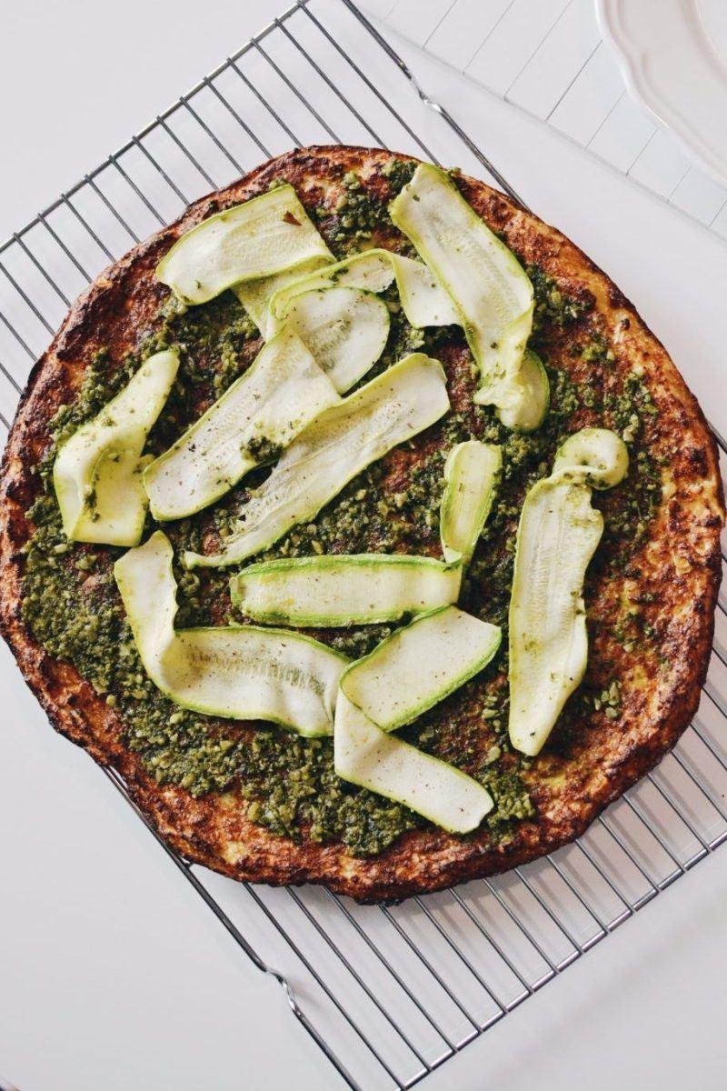 Cauliflower pizza with zucchini & pesto Recipe | HeyFood — heyfoodapp.com