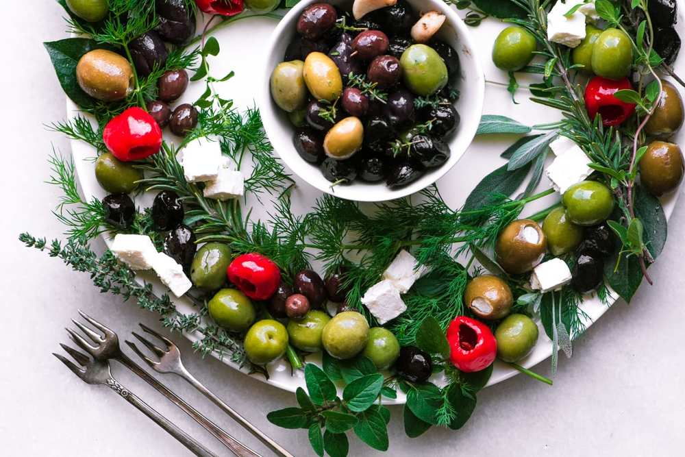 Festive Olive Wreath Appetizer Recipe | HeyFood — heyfoodapp.com