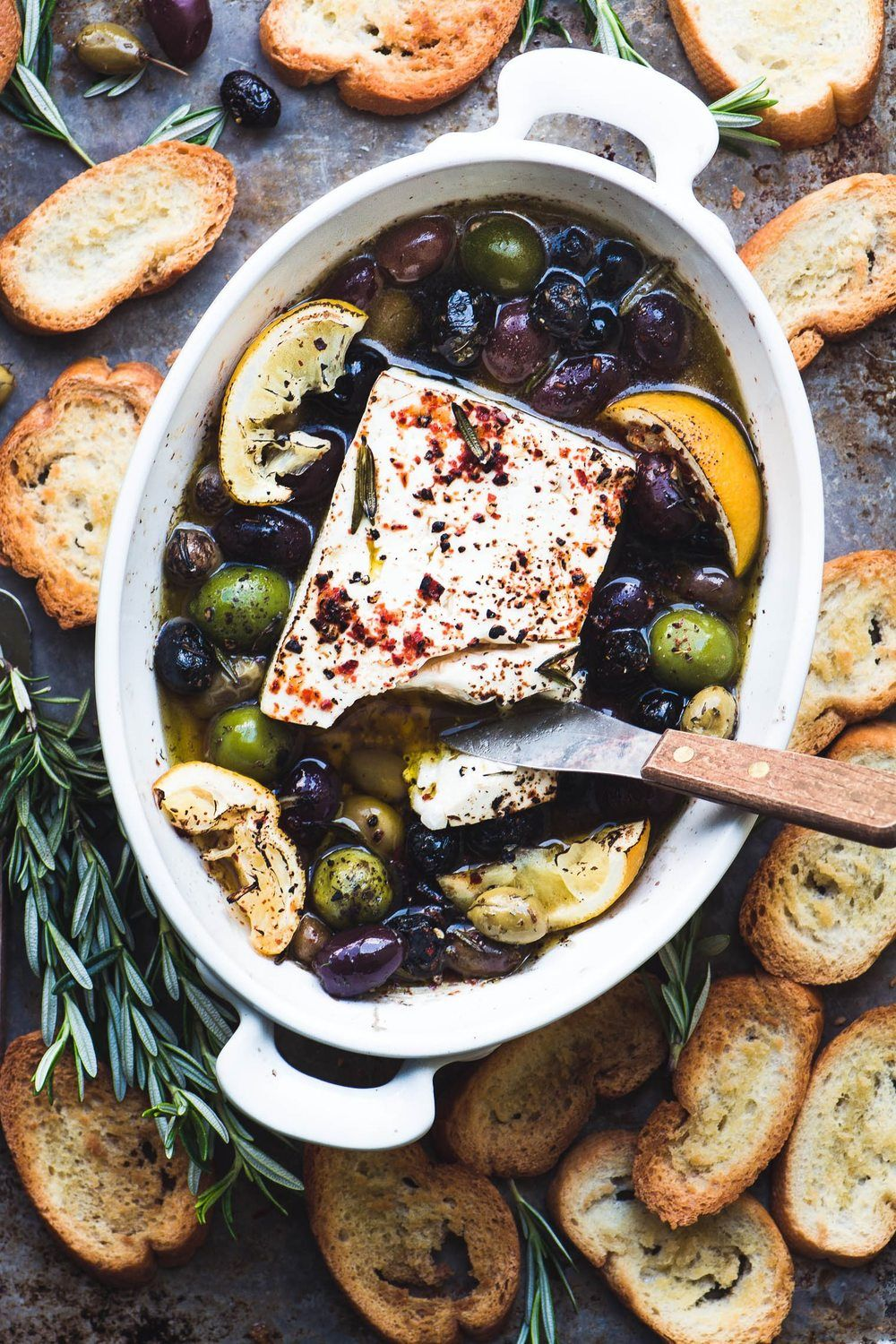 Baked Feta Cheese with Olives, Lemon and Rosemary Recipe | HeyFood — heyfoodapp.com