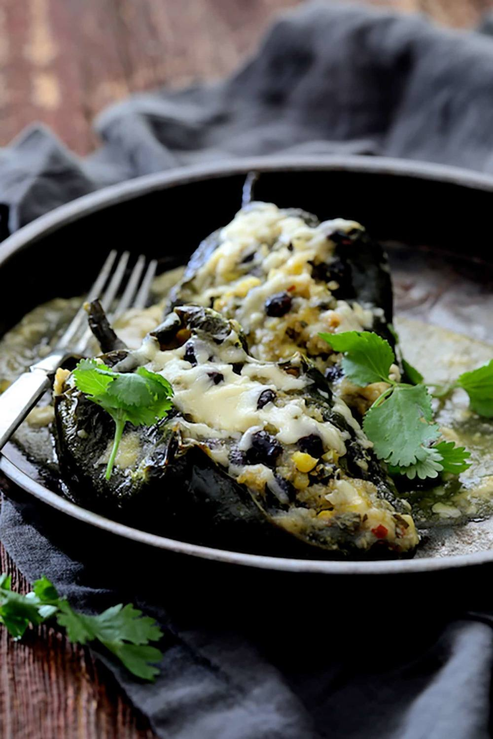 Quinoa Corn and Black Bean Stuffed Poblanos Recipe | HeyFood — heyfoodapp.com